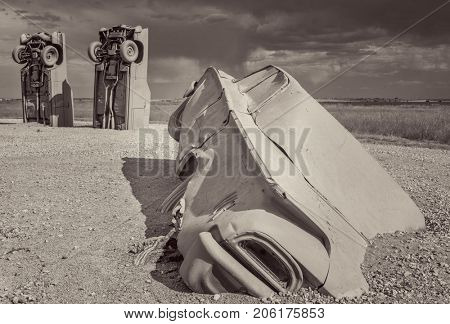 ALLIANCE, NE, USA - July 9, 2017:  Carhenge - famous car sculpture  created by Jim Reinders, a modern replica of  England's Stonehenge using old cars., black and white platinum toned image.