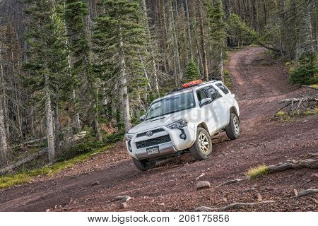 Villa Grove, CO, USA - September 16, 2017: Toyota 4Runner SUV (2016 Trail Premium Edition) on a steep  Hayden Pass Road in Sangre de Cristo Mountains, the southernmost subrange of the Rocky Mountains,