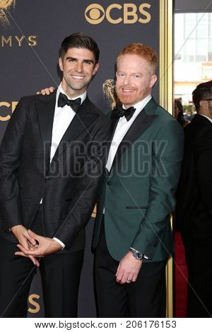 LOS ANGELES - SEP 17:  Justin Mikita, Jesse Tyler Ferguson at the 69th Primetime Emmy Awards - Arrivals at the Microsoft Theater on September 17, 2017 in Los Angeles, CA