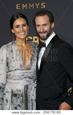 LOS ANGELES - SEP 17:  Maria Dolores Dieguez, Joseph Fiennes at the 69th Primetime Emmy Awards - Arrivals at the Microsoft Theater on September 17, 2017 in Los Angeles, CA