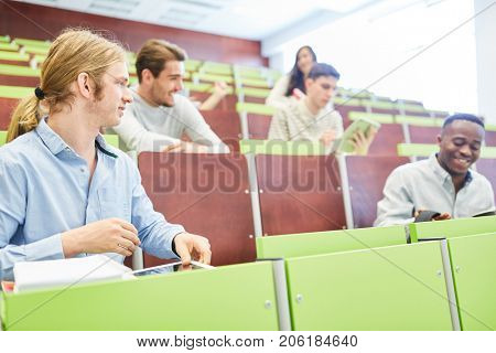 Students at university lecture hall learn together