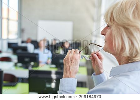 Senior woman as lecturer or teacher in university or college