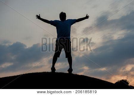 silhoutte of happy guy enjoying him self