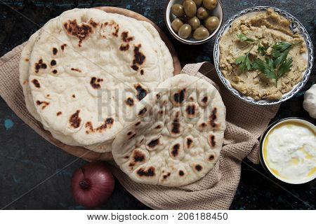 Home made pita bread, flatbread popular in turkish, lebanese and other oriental cuisines