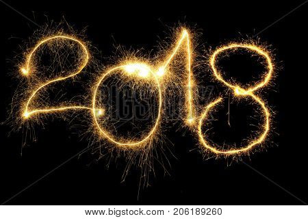New Year 2018 formed from sparking digits over black background