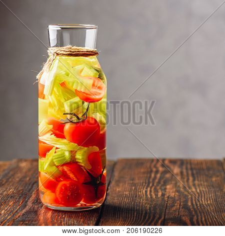 Water Infused with Cherry Tomato and Celery. Copy Space on the RIght Side.