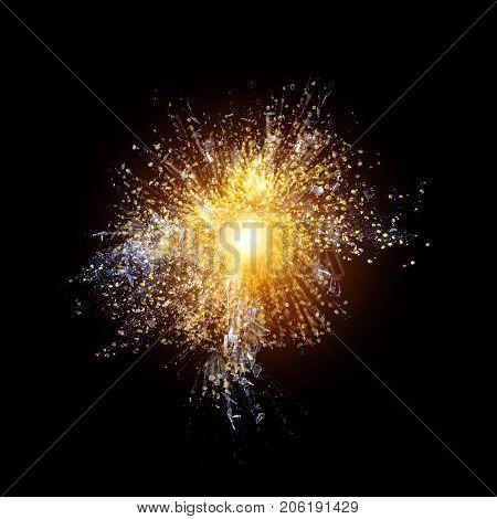 detail of golden explosion on black backgroud