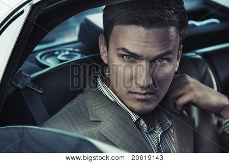 Portrait of a sexy man in the car