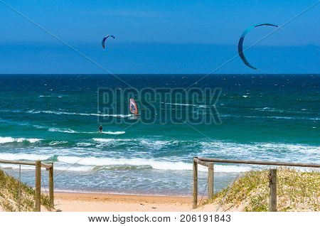 Sydney Australia - November 9 2014: Wind surfers and kite surfers on Cronulla beach on sunny day