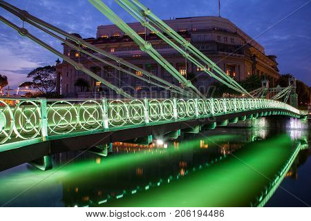Brightly lit Cavenagh Bridge is one of the oldest bridges and the only cable-stayed suspension bridge in Singapore spanning the lower reaches of the Singapore River. Opened in 1870 it was named after William Orfeur Cavenagh the last India-appointed Govern