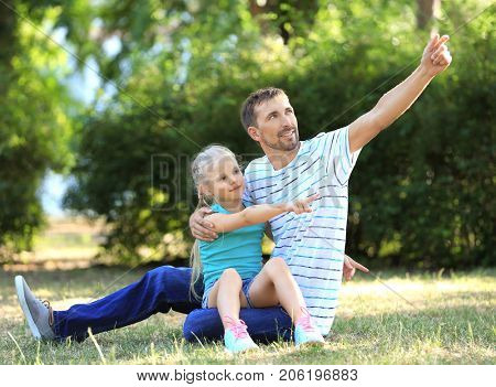 Young man with little girl in park
