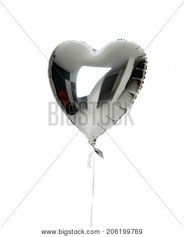 Single big  silver heart balloon object for birthday  party isolated on a white background