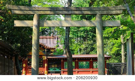 tori gate stone door to get in to the peaceful temple in the forest.
