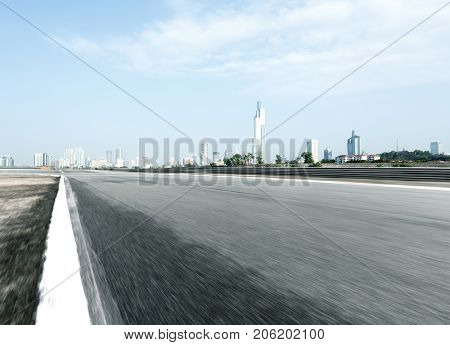 blurry empty asphalt road with cityscape of nanjing in blue sky