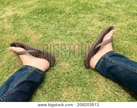 My foot, foot sandal and jeans pants