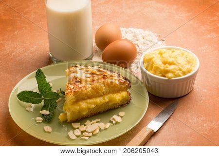 homemade cake with almonds and custard cream