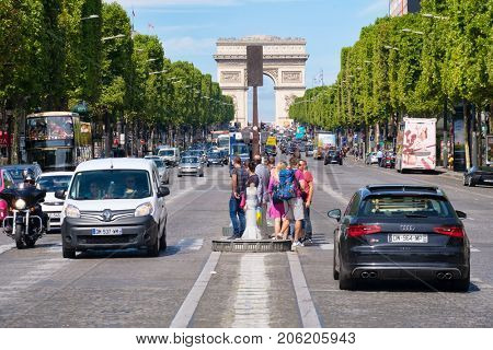 PARIS,FRANCE - JULY 29,2017 : The Champs-Elysees with the Arc de Triomphe in central Paris on the background