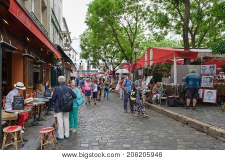 PARIS,FRANCE - JULY 31,2017 : Typical restaurants and artists selling their paintings at the Place du Tertre in Montmartre