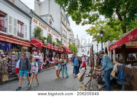 PARIS,FRANCE - JULY 31,2017 : Typical restaurants , gift shops and artists selling their paintings at the Place du Tertre in Montmartre