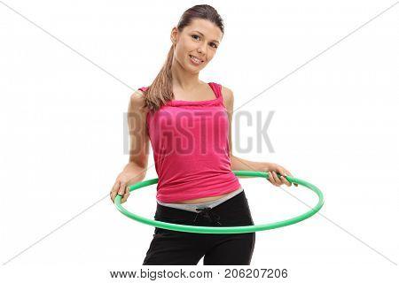 Female athlete exercising with a hula-hoop isolated on white background