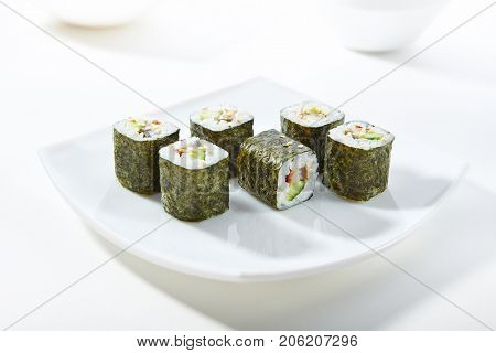 Roll made of Smoked Eel and Cucumber inside. Nori outside