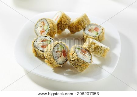Tempura Maki Sushi - Deep Fried Roll made of Smoked Eel, Salmon, Cucumber and Cream Cheese inside