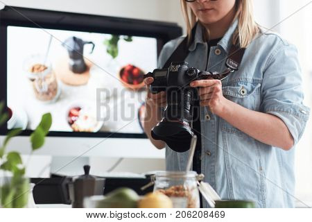 Young modern photographer working in photo studio