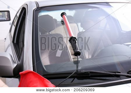 Fixing crack on car windshield in repair shop