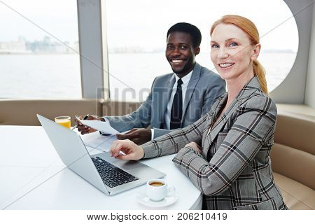 Successful business partners traveling together by steamship