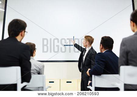 Ambitious financier or director of company explaining his subordinates principles of market development