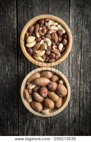 Different types of nuts. Hazelnuts, walnuts, almonds, brazil nuts and pistachio nuts in wooden bowl.