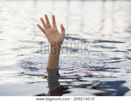 Drowning victims Hand of drowning woman needing help. Failure and rescue concept.