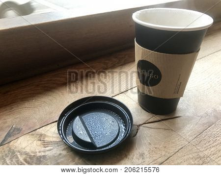 LONDON - SEPTEMBER 19, 2017: Hot steaming coffee in a disposable takeaway cup in London, UK.