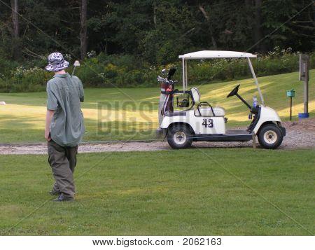 Golfer & Golf Cart