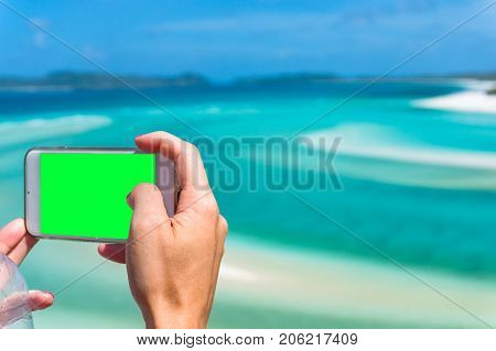 Tourist Taking Photo Of Beautiful Tropical Beach Landscape With Her Smartphone