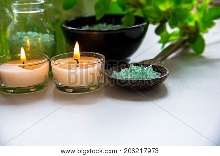 Thai Spa Treatments aroma therapy salt and nature green sugar scrub and rock massage with green orchid flower on wooden white with candle. Thailand. Healthy Concept. copy spaceselect and soft focus