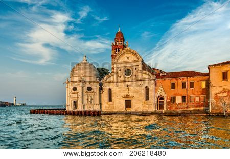 Church San Michele in Isola Venice Italy at background blue sky with cloud landscape.