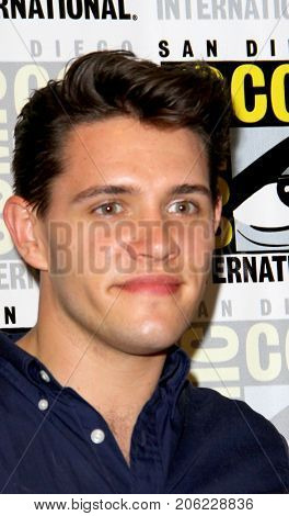 Casey Cott arrives at the 2017 Comic Con press room at the Hilton San Diego Bayfront hotel on July 22, 2017 in San Diego, CA.