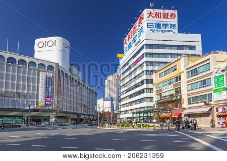 TOKYO, JAPAN - NOVEMBER 13, 2016: Streets of Ikebukuro district of Tokyo metropolis, Japan. Tokyo Metropolis is both the capital and most populous city of Japan.