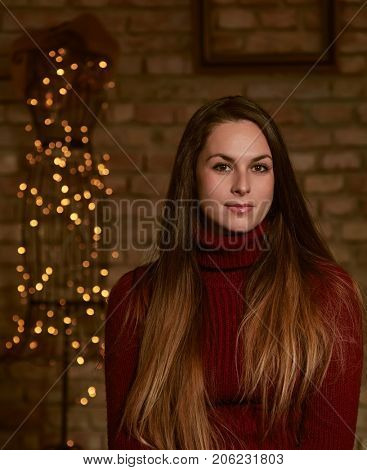 Winter portrait of attractive young woman in turtleneck pullover.