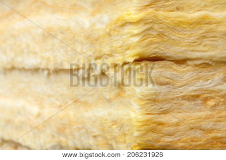 Mineral wool (or mineral fiber, mineral cotton, mineral fibre, glass wool, MMMF, MMVF) fiber thermal insulation close-up