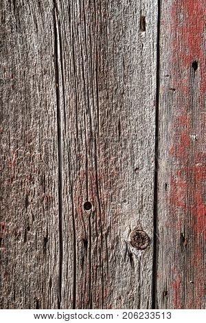 Red worn barn wooden board closeup