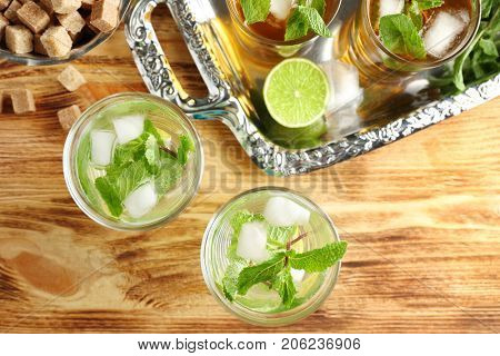 Composition with mint julep and metal tray on wooden table