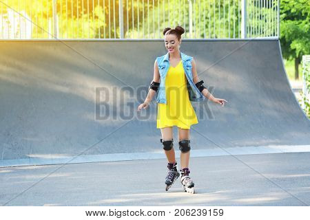 Young woman rollerskating outdoors