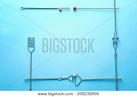 Frame made of logopedic probes for speech correction on color background