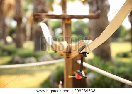 Wooden bow for archery outdoors
