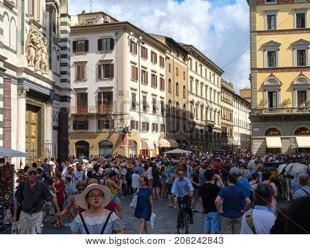 FLORENCE,ITALY - JULY 25,2017 : Tourists at Piazza del Duomo in the medieval city of Florence, Italy