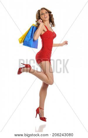 Young Woman wearing red dress with shopping bags isolated on a white background