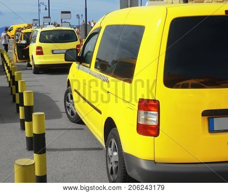 Bright yellow taxi cabs in parking zone