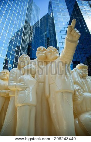 MONTREAL, CANADA - SEPT 14, 2017: The Illuminated Crowd created by Raymond Mason is sculpture of 65 people of all ages, facial expressions and conditions illustrates the degradation of the human race
